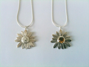 Two completed daisy pendants by Sarah Ana Designs