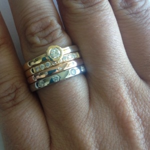 Stacking rings in 14k and 18k gold with diamonds.